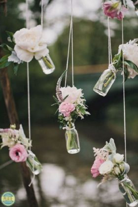 Hanging Bottles With Fresh Flowers
