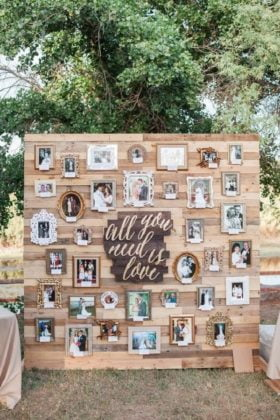 Pallet backdrop with couple photographs